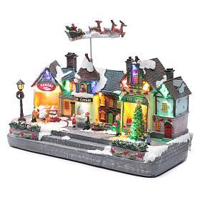 Bożonarodzeniowe miasteczko oświetlone z melodią ruchem reniferów choinki postaci na zlodowaciałym jeziorze 27x41x17 cm s2
