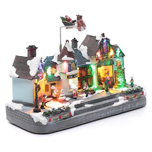 Bożonarodzeniowe miasteczko oświetlone z melodią ruchem reniferów choinki postaci na zlodowaciałym jeziorze 27x41x17 cm 3