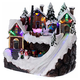 Pueblo navideño luminoso musical movimiento tren lago congelado 23x21x16 cm s3