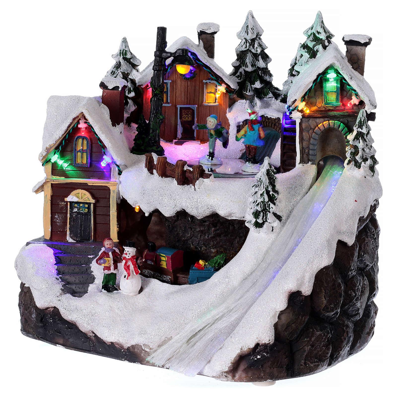 Village Noël lumineux musical mouvement train lac glacé 23x21x16 cm 3