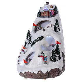 Christmas village illuminated with music movement and skiers 28X19X23 cm s3