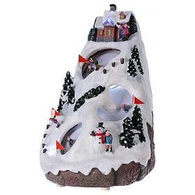 Aldea navideña iluminada musical movimiento esquiadores s3