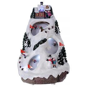 Villaggio natalizio luminoso musicale movimento sciatori 28X19X23 cm s1