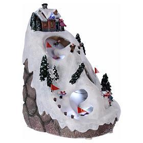 Villaggio natalizio luminoso musicale movimento sciatori 28X19X23 cm s4