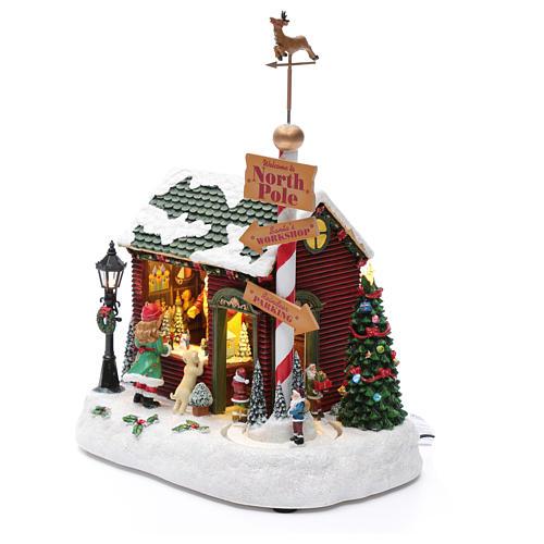 Pueblo Navideño Taller de Papá Noel y Enanitos, Luces, Música, Movimientos 30X25X17 cm 2