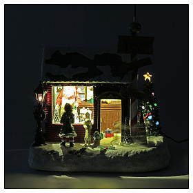 Lighted Christmas village with Santa, rotating elves and music 30x25x17 cm s4
