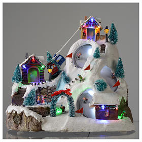 Christmas village illuminated with music, movement, ice rink and small lake 29X31X22 cm s2