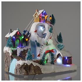 Aldea navideña iluminada musical movimiento pista de esquí lago 29x31x22 cm cm s3