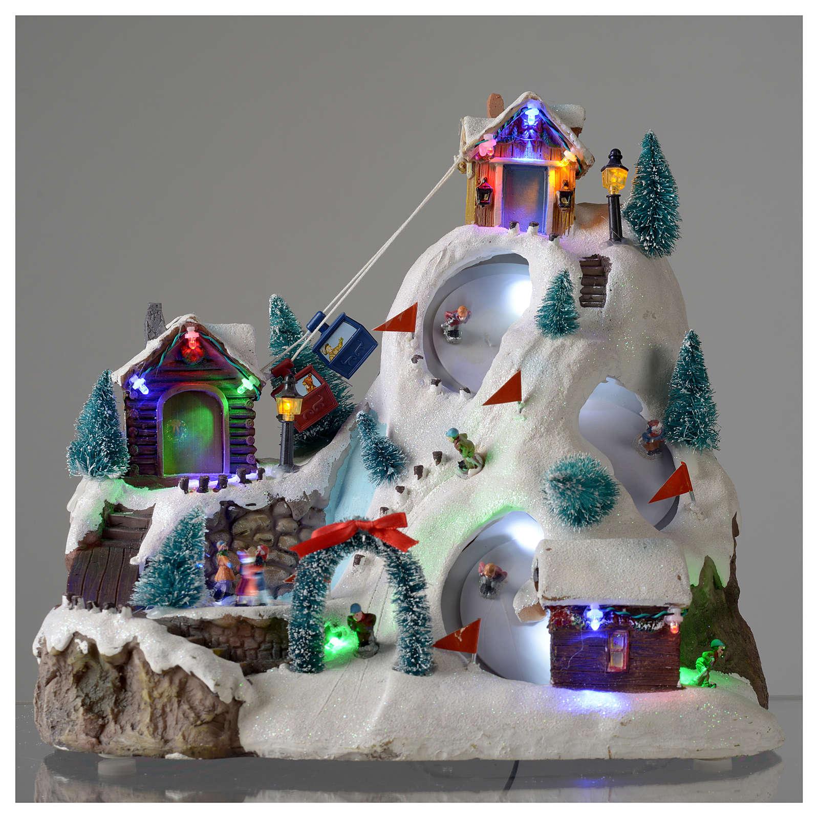 Villaggio natalizio luminoso musicale movimento pista sci laghetto 29X31X22 cm 3