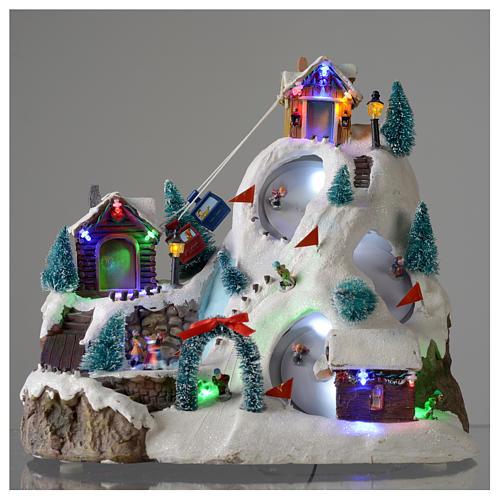 Villaggio natalizio luminoso musicale movimento pista sci laghetto 29X31X22 cm 2
