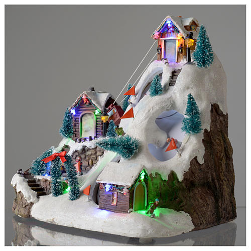 Villaggio natalizio luminoso musicale movimento pista sci laghetto 29X31X22 cm 4