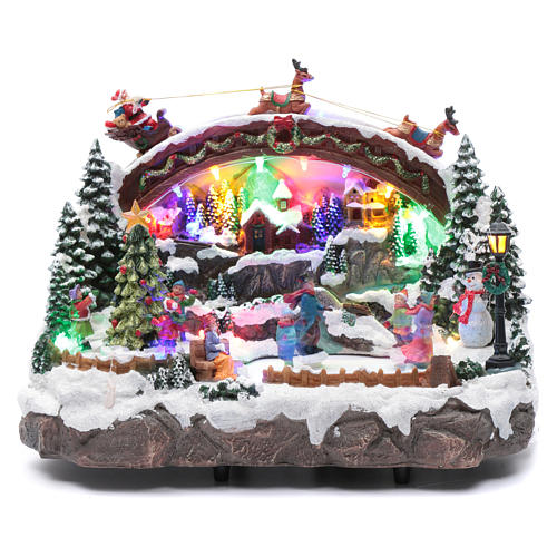 Christmas village with music, lighting, moving ice skaters and Christmas tree 24X33X21 cm 1