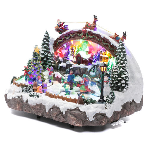 Christmas village with music, lighting, moving ice skaters and Christmas tree 24X33X21 cm 2