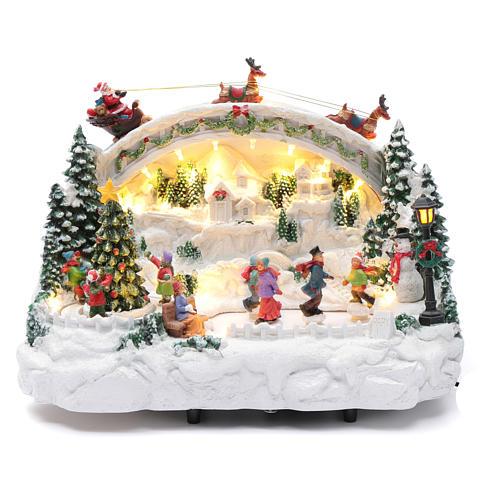 Villaggio natalizio bianco luminoso musica movim pattinatori albero natale 24X33X21 cm 1