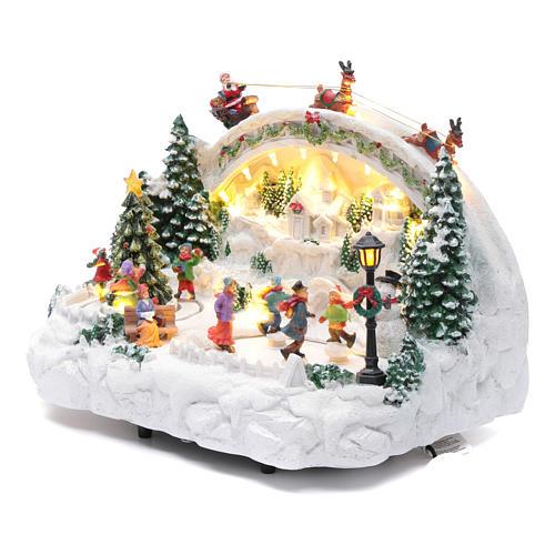 Villaggio natalizio bianco luminoso musica movim pattinatori albero natale 24X33X21 cm 2