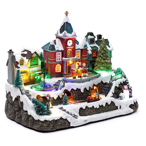 LIghted Christmas village with rotating train, fountain and music 28x34x19 cm 3