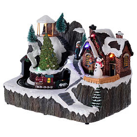 Illuminated Christmas village with music and moving train 19X23X16 cm s3