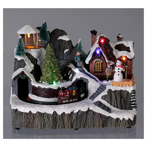 Illuminated Christmas village with music and moving train 19X23X16 cm 2