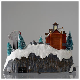 Christmas village with firemen and moving train 23X27X17 cm s5