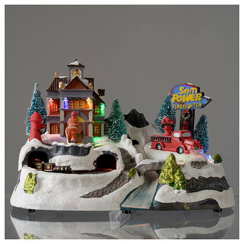 Christmas village with firemen and moving train 23X27X17 cm 2