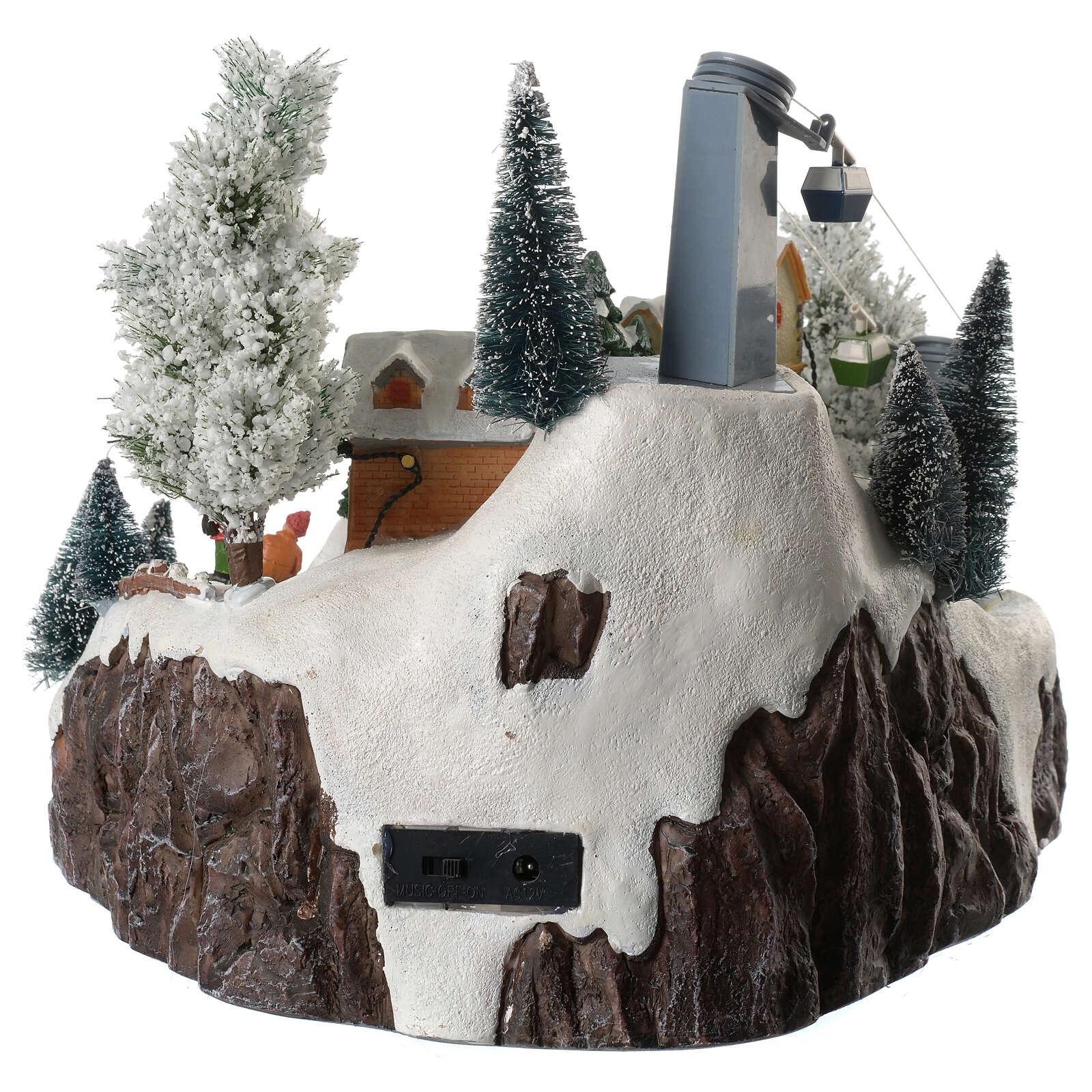 Weihnachtsdorf Spieluhr mit Lichtern Skifahrer und Seilbahn 30x25x25 cm 3