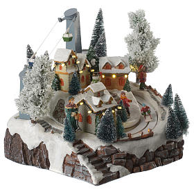 Christmas village with skiers and cable car with illumination and music 30x25x25 cm s3