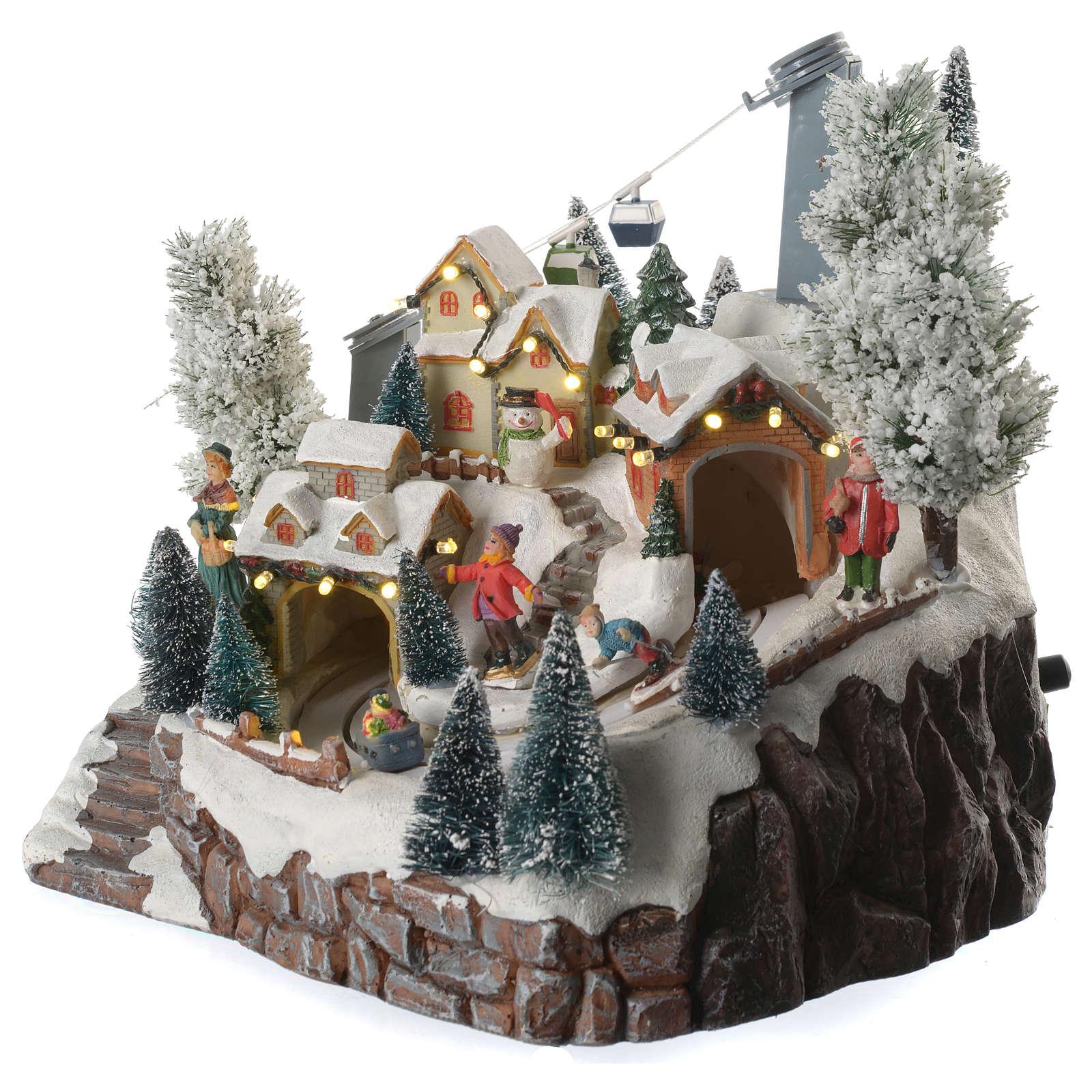 Villaggio natalizio sciatori e funivia in movimento illuminato e musicale 30x25x25 3