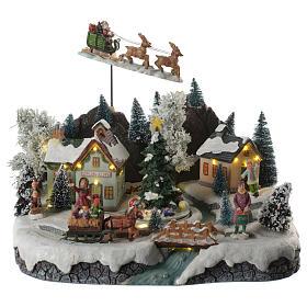 Villaggio natalizio babbo natale in volo in movimento illuminato con musica 30x25x25 s1