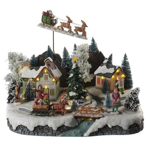 Villaggio natalizio babbo natale in volo in movimento illuminato con musica 30x25x25 1