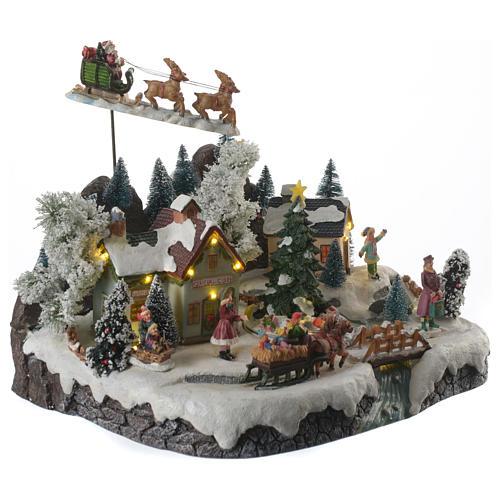 Villaggio natalizio babbo natale in volo in movimento illuminato con musica 30x25x25 2