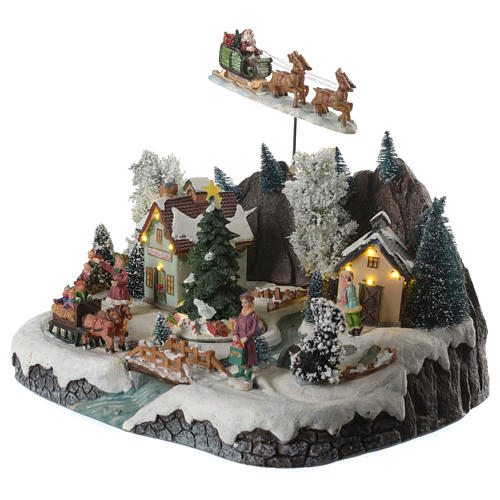 Villaggio natalizio babbo natale in volo in movimento illuminato con musica 30x25x25 3