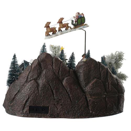 Villaggio natalizio babbo natale in volo in movimento illuminato con musica 30x25x25 4