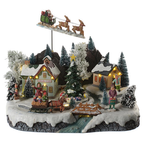 christmas village scene with santa claus animated sounds and lights 30x25x25 cm 1 - Animated Christmas Village