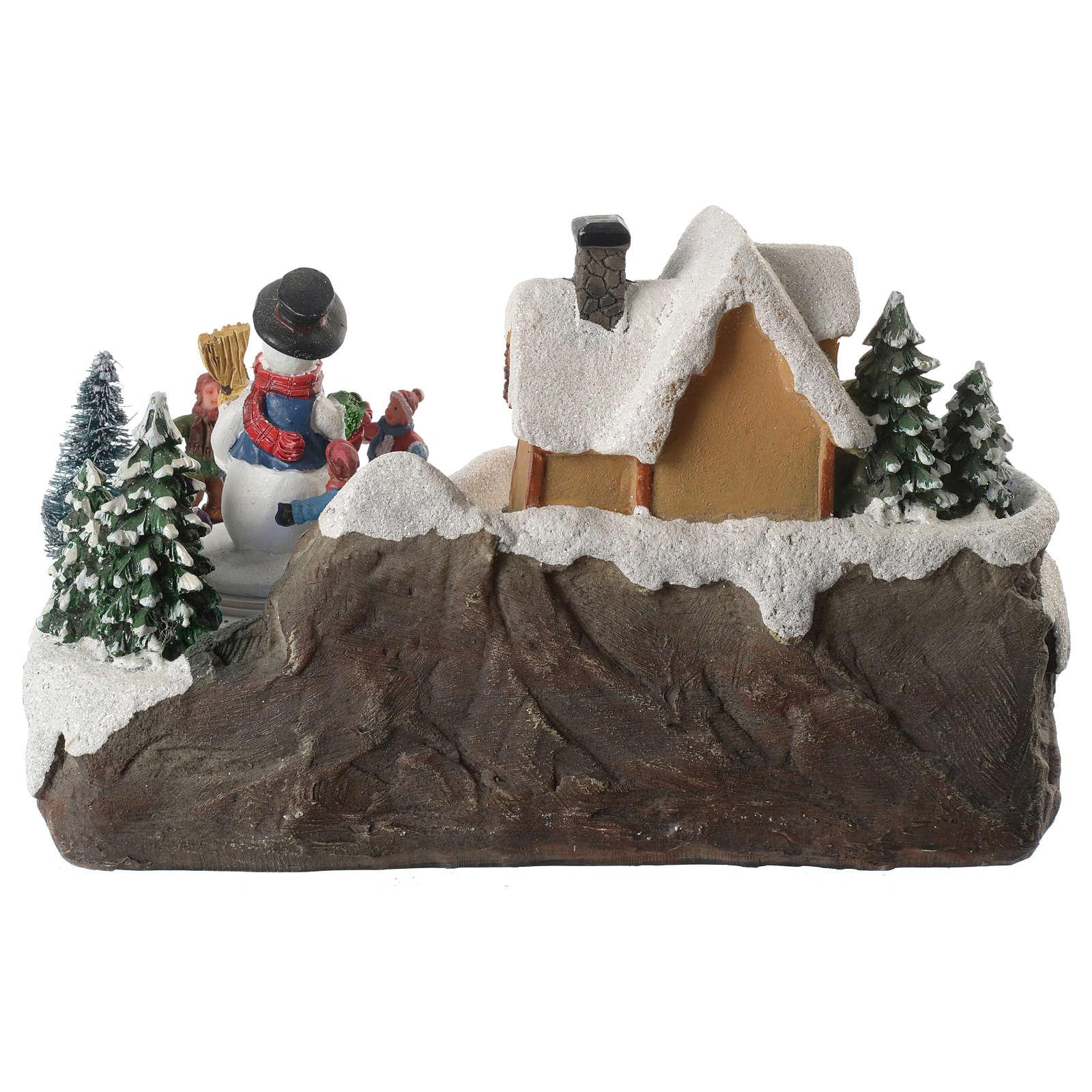 Winterszene Kinder um Schneemann 20x20x20cm Licht und Bewegung 3