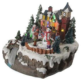 Winterszene Kinder um Schneemann 20x20x20cm Licht und Bewegung s2