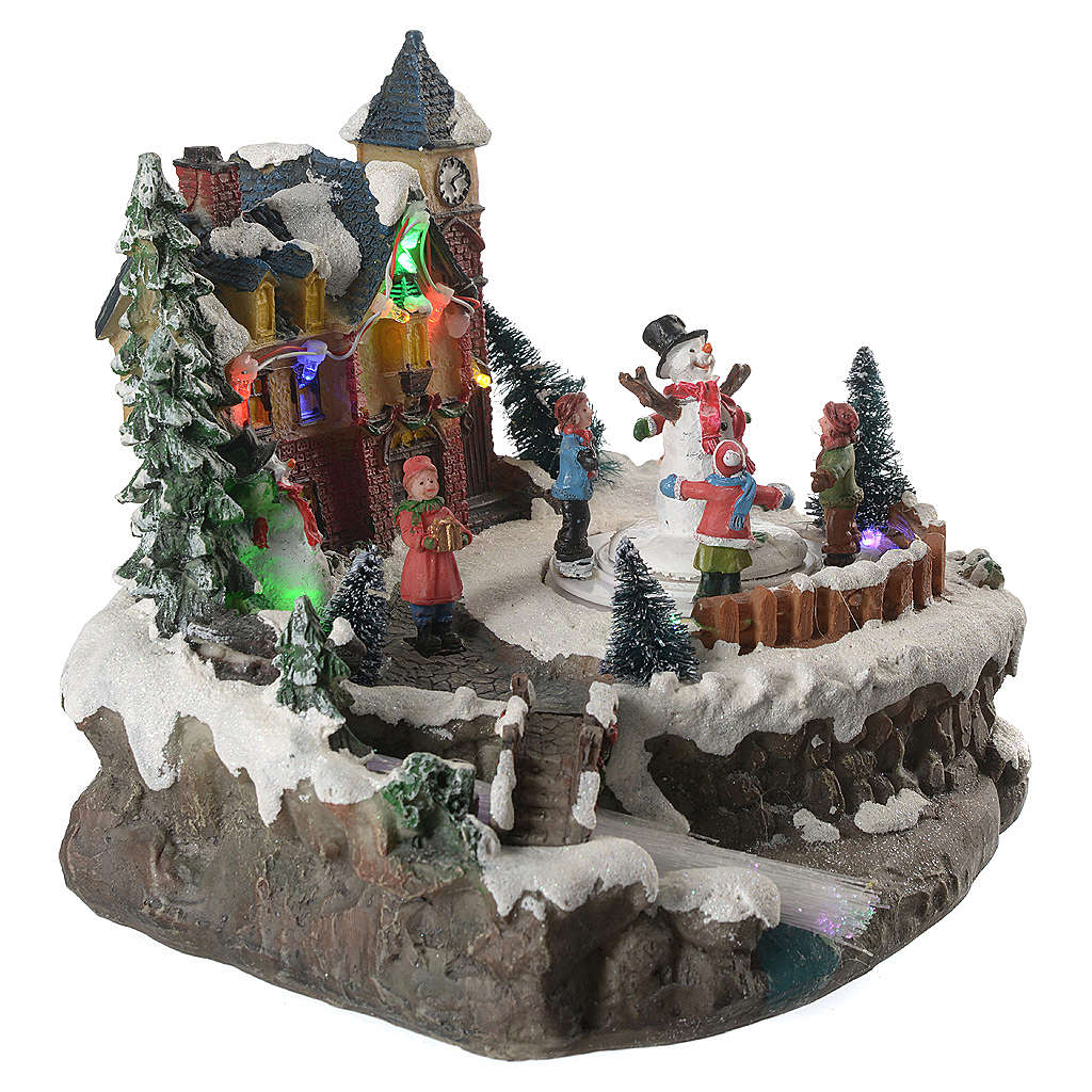Christmas village with children and illuminated river with movement 20x20x20 3