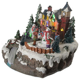 Christmas village with children and illuminated river with movement 20x20x20 s11