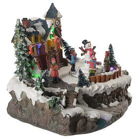 Christmas village with children and illuminated river with movement 20x20x20 s12
