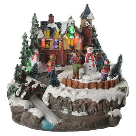 Christmas village with children and illuminated river with movement 20x20x20 s1