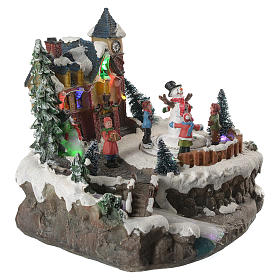 Christmas village with children and illuminated river with movement 20x20x20 s3