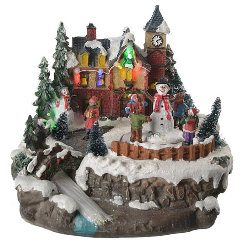 Christmas village with children and illuminated river with movement 20x20x20 10