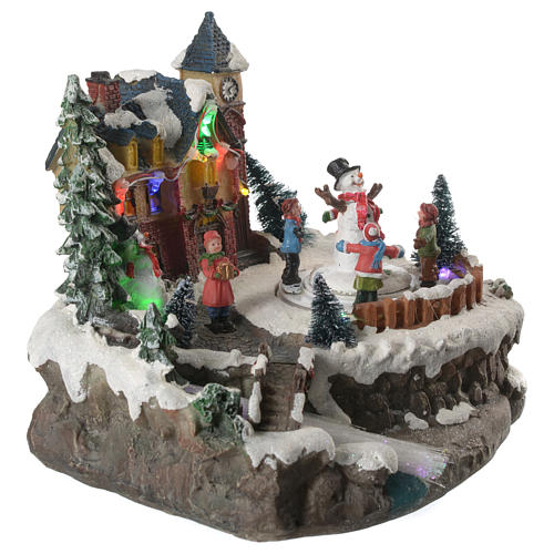Christmas village with children and illuminated river with movement 20x20x20 12