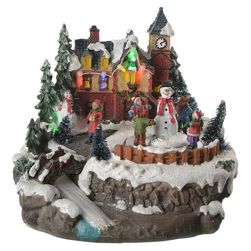 Christmas village with children and illuminated river with movement 20x20x20 1