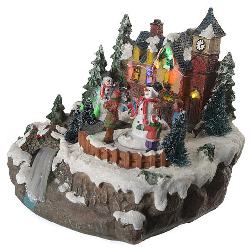 Christmas village with children and illuminated river with movement 20x20x20 2
