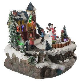 Village de Noël enfants en mouvement rivière éclairée 22x21x20 cm s12