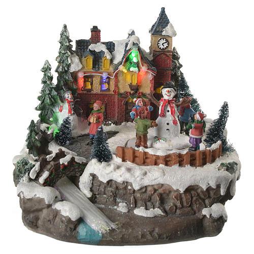 Village de Noël enfants en mouvement rivière éclairée 22x21x20 cm 1