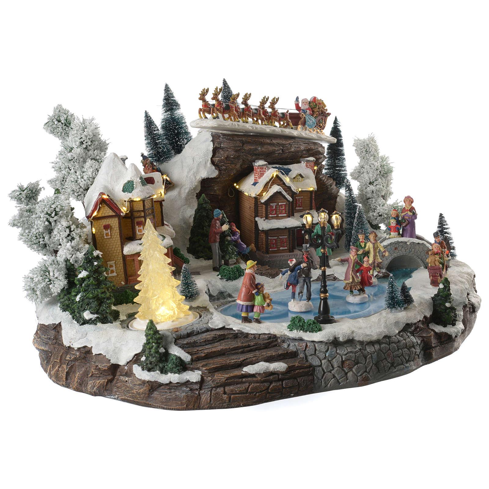 Villaggio natalizio lago pattinatori e slitta in movimento illuminato e musicale 55x40x30 3