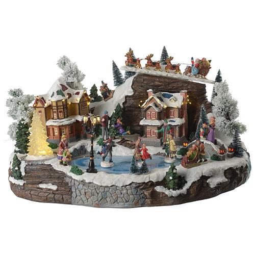 Villaggio natalizio lago pattinatori e slitta in movimento illuminato e musicale 55x40x30 1