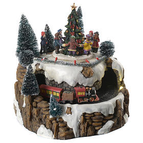 Christmas villages sets: Christmas village with train and children in movement with lights and music 25x20 cm