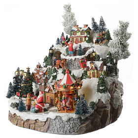 Christmas village with mountains and horses equipped with lights and music 35x35x30 cm s2